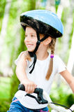 Girl on  the bicycle Royalty Free Stock Photo