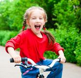 Girl with bicycle Royalty Free Stock Image