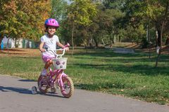 Girl on the bicycle Royalty Free Stock Photography