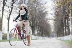 Girl on the bicycle Stock Image