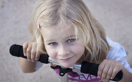 Girl with bicycle Royalty Free Stock Photography