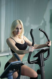 Girl on bicycle Stock Images