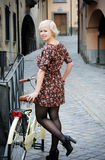 Girl with a bicycle Stock Photo