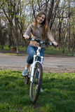 Girl on bicycle. Beautiful young woman riding her bicycle Royalty Free Stock Photography