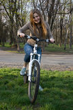 Girl on bicycle. Young girl riding a bicycle Stock Images
