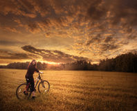 Girl on the bicycle Stock Photos