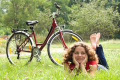 Girl and bicycle royalty free stock image