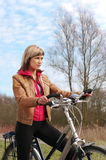 Girl with a bicycle Royalty Free Stock Photography