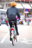 Girl on bicycle in Amsterdam Royalty Free Stock Photo