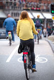 Girl on bicycle in Amsterdam Stock Image