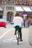 Girl on bicycle in Amsterdam Royalty Free Stock Photos