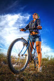 Girl with a bicycle Stock Image