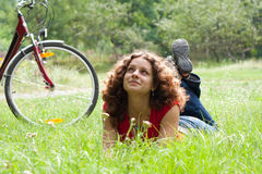 Girl with a bicycle. Beautiful girl with a bicycle  on the grass Stock Images