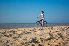 The girl with bicycle Stock Photo