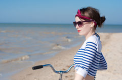 The girl with bicycle Stock Photography