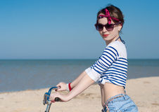 The girl with bicycle Stock Image