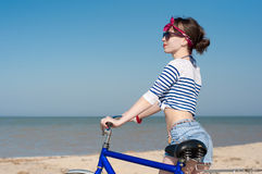 The girl with bicycle royalty free stock photo