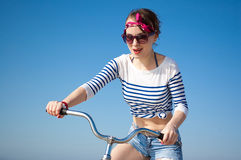 The girl with bicycle Stock Images