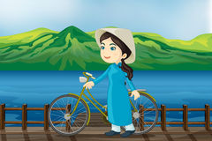 A girl with bicycle on a bench Royalty Free Stock Photos