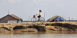 Girl on Bicycle in Cambodia Stock Photos
