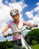 Girl with bicycle. Close shot. Cyclist girl looking at camera, close shot stock image