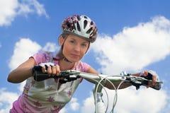 Girl with bicycle. Close shot. Cyclist girl looking at camera, close shot royalty free stock photo