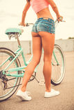 Girl with bicycle. Royalty Free Stock Images