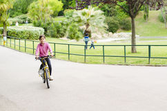 Girl with Bicycle Stock Photography