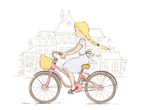 Girl on a bicycle in a European city Royalty Free Stock Photos