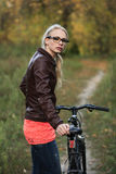 Girl on bicycle in forest Stock Image