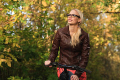 Girl on bicycle in forest Royalty Free Stock Photo
