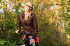 Girl on bicycle in forest Royalty Free Stock Images