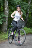 Girl on a bicycle Stock Photos