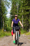 Girl on the bicycle in the forest Royalty Free Stock Images