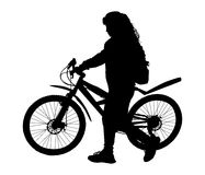 Girl with a bicycle. Girl goes for a walk with the bike Stock Images