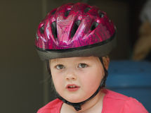 Girl with bicycle helmet Stock Images