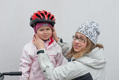 Girl in a bicycle helmet Royalty Free Stock Photos