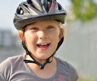 Girl in a bicycle helmet. Stock Photo