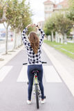 Girl with bicycle makes  heart shape with hands, healthy concept Royalty Free Stock Images