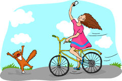 Girl on bicycle making selfie. Royalty Free Stock Image