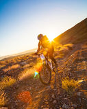 Girl on a bicycle in the mountains Stock Photo