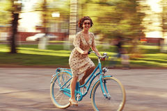 Girl on a bicycle in movement Royalty Free Stock Photography