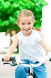 Girl on a bicycle in the park Stock Photos