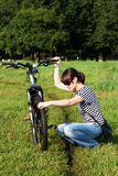 A girl with a bicycle in the park Royalty Free Stock Photos