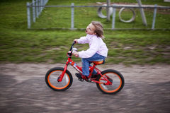 Girl on bicycle. In park Royalty Free Stock Photo