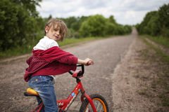 Girl on bicycle. In park Royalty Free Stock Image