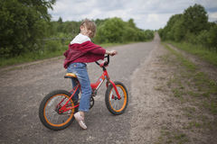 Girl on bicycle. In park Stock Image