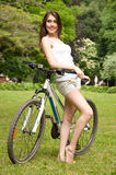 Girl with a bicycle Royalty Free Stock Images