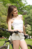 Girl with a bicycle Royalty Free Stock Photo