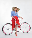 Girl with a bicycle in a retro style. Blonde girl with a bicycle in a retro style on a white background Royalty Free Stock Photos